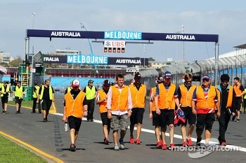 Hi-vis jackets worn as support race teams walk the circuit