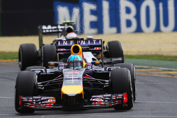 Sebastian Vettel, Red Bull Racing RB10 leads Kevin Magnussen, McLaren MP4-29