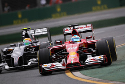 Fernando Alonso, Ferrari F14-T and Esteban Gutierrez, Sauber C33