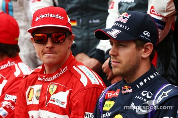 (L to R): Kimi Raikkonen, Ferrari with Sebastian Vettel, Red Bull Racing at the drivers start of season photograph