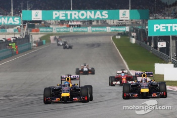 (L to R): Sebastian Vettel, Red Bull Racing RB10 and team mate Daniel Ricciardo, Red Bull Racing RB10 battle for position
