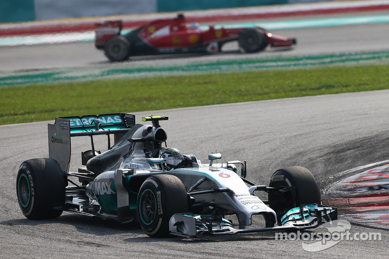 Nico Rosberg, Mercedes AMG F1 W05 leads Fernando Alonso, Ferrari