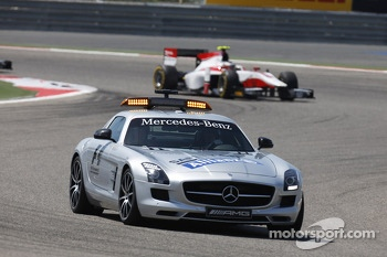 The safety car leads the pack