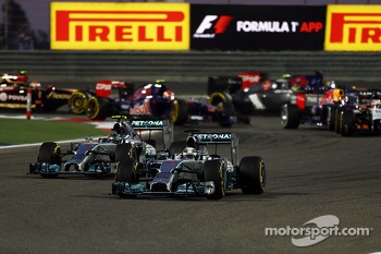 Lewis Hamilton, Mercedes AMG F1 W05 leads team mate Nico Rosberg, Mercedes AMG F1 W05 at the start of the race