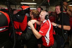 The Marussia F1 Team celebrate Jules Bianchi, scoring their first F1 points