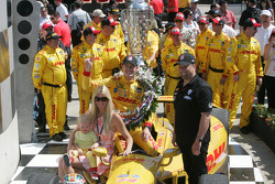 Ryan Hunter-Reay, wife Beccy, son Ryden and team owner Michael Andretti of Andretti Auto Sport celebrate in Victory Circle after winning the 98th Running of the Indianapolis 500 Mile Race
