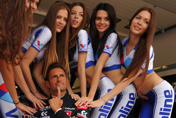 Gianni Morbidelli with lovely grid girls
