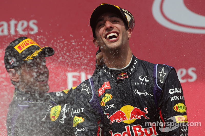 Race winner Daniel Ricciardo, Red Bull Racing celebrates on the podium with team mate Sebastian Vettel, Red Bull Racing