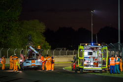 Medical staff tend to Fernando Rees following his crash Wednesday night