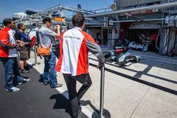 Porsche team members watch the repairs on the #1 Audi Sport Team Joest Audi R18 E-Tron Quattro