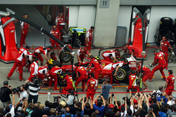 Ferrari practices a pit stop during a fans' pit lane walkabout session