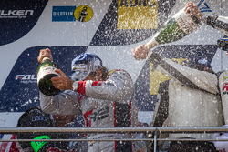 Podium: champagne for Markus Winkelhock and Nico Bastian