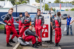 LEMANS: Audi Sport Team Joest team members wait for the crashed #1 Audi Sport Team Joest Audi R18 E-Tron Quattro