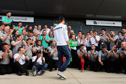 Nico Rosberg, Mercedes AMG F1 comes to celebrate victory for team mate Lewis Hamilton, Mercedes AMG F1 with the team