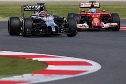 Jenson Button, McLaren MP4-29 and Fernando Alonso, Ferrari F14-T