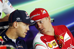 (L to R): Sebastian Vettel, Red Bull Racing and Kimi Raikkonen, Ferrari in the FIA Press Conference