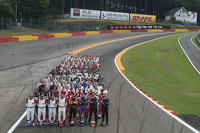 Drivers group photo at Eau Rouge