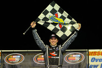 Race winner Daniel Suarez celebrates