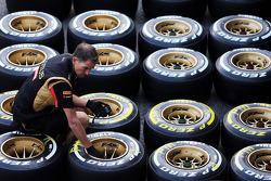 Lotus F1 Team mechanic prepares Pirelli tyres
