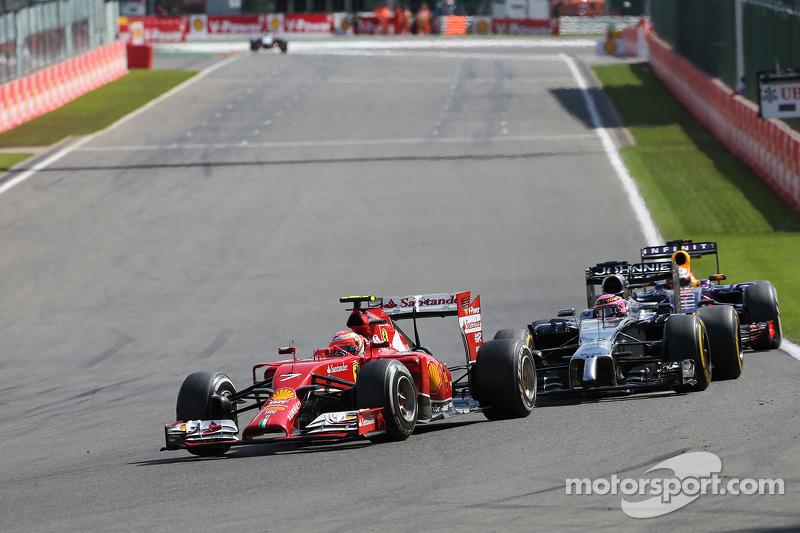 Kimi Raikkonen, Scuderia Ferrari and Jenson Button, McLaren F1 Team