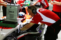 Johnny Herbert, Sky Sports F1 Presenter works with the Marussia F1 Team mechanics