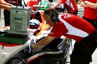 Johnny Herbert, Sky Sports F1 Presenter works with the Marussia F1 Team mechanics