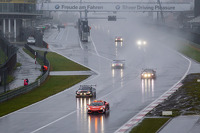 Race action behind the safety car