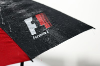 Rain falls on an F1 umbrella