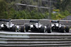 Kevin Magnussen, McLaren MP4-29; Nico Rosberg, Mercedes AMG F1 W05; and Lewis Hamilton, Mercedes AMG F1 W05