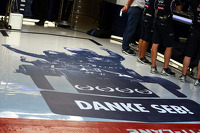 The Red Bull Racing team thank Sebastian Vettel, Red Bull Racing with a mural on the pit garage floor