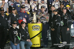 Victory lane: race winner Jimmie Johnson accepts the victory trophy