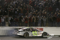 Race winner Jimmie Johnson celebrates victory