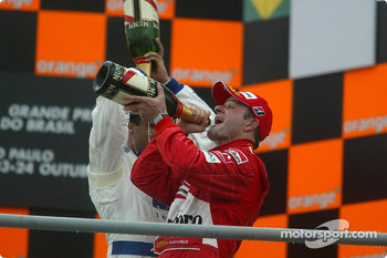 Podium: champagne for Juan Pablo Montoya and Rubens Barrichello
