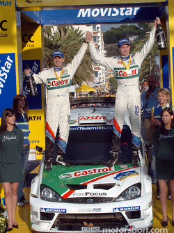 Podium: rally winners Markko Martin and Michael Park celebrate