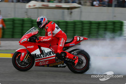 Troy Bayliss celebrates with a burnout