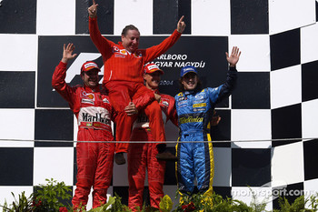 Podium: Rubens Barrichello, Jean Todt, Michael Schumacher and Fernando Alonso