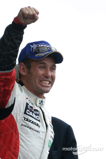 LM P1 podium: race winner Tom Kristensen celebrates