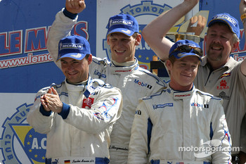 GT podium: winners Sascha Maassen, Jorg Bergmeister and Patrick Long celebrate