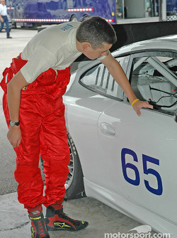 Brad Coleman looking into The Racer's Group test car