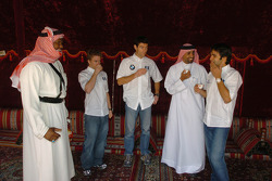 Antonio Pizzonia, Mark Webber and Nick Heidfeld have tea in an Arabian tent