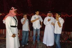 Antonio Pizzonia, Mark Webber and Nick Heidfeld have tea in an Arabian tent