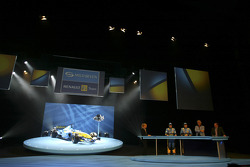 Fernando Alonso, Giancarlo Fisichella and Flavio Briatore on stage
