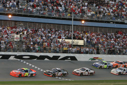 Jeff Gordon takes the white flag ahead of Kurt Busch and Dale Earnhardt Jr.