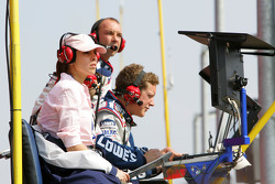 Actress Jamie Lynn Dscala from the television series The Sopranos sits in the pitbox of Jimmie Johnson