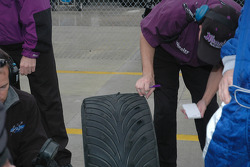 Hoosier crew members check tires
