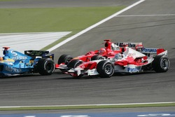 Michael Schumacher and Jarno Trulli battle