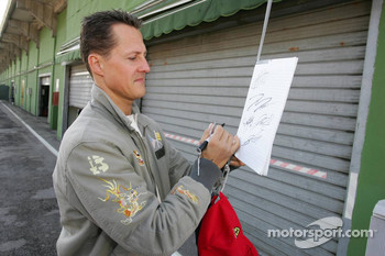 Michael Schumacher signs autographs