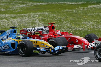 Giancarlo Fisichella battles with Michael Schumacher