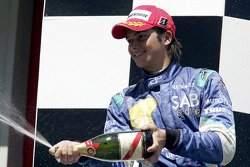 Podium: champagne for Nelson A. Piquet