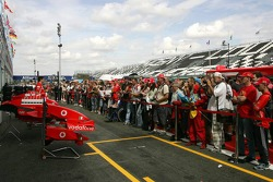 Fans have a look at the Ferrari pitbox